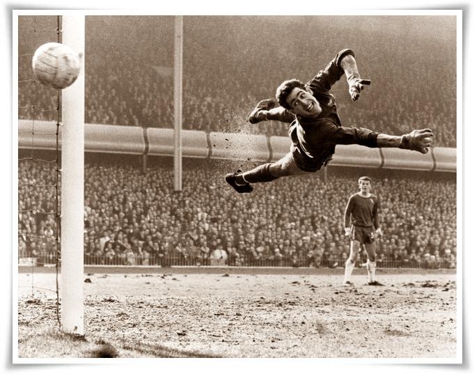 Chelsea goalkeeper Peter Bonetti makes a flying save, watched by team mate Eddie McCreadie.
